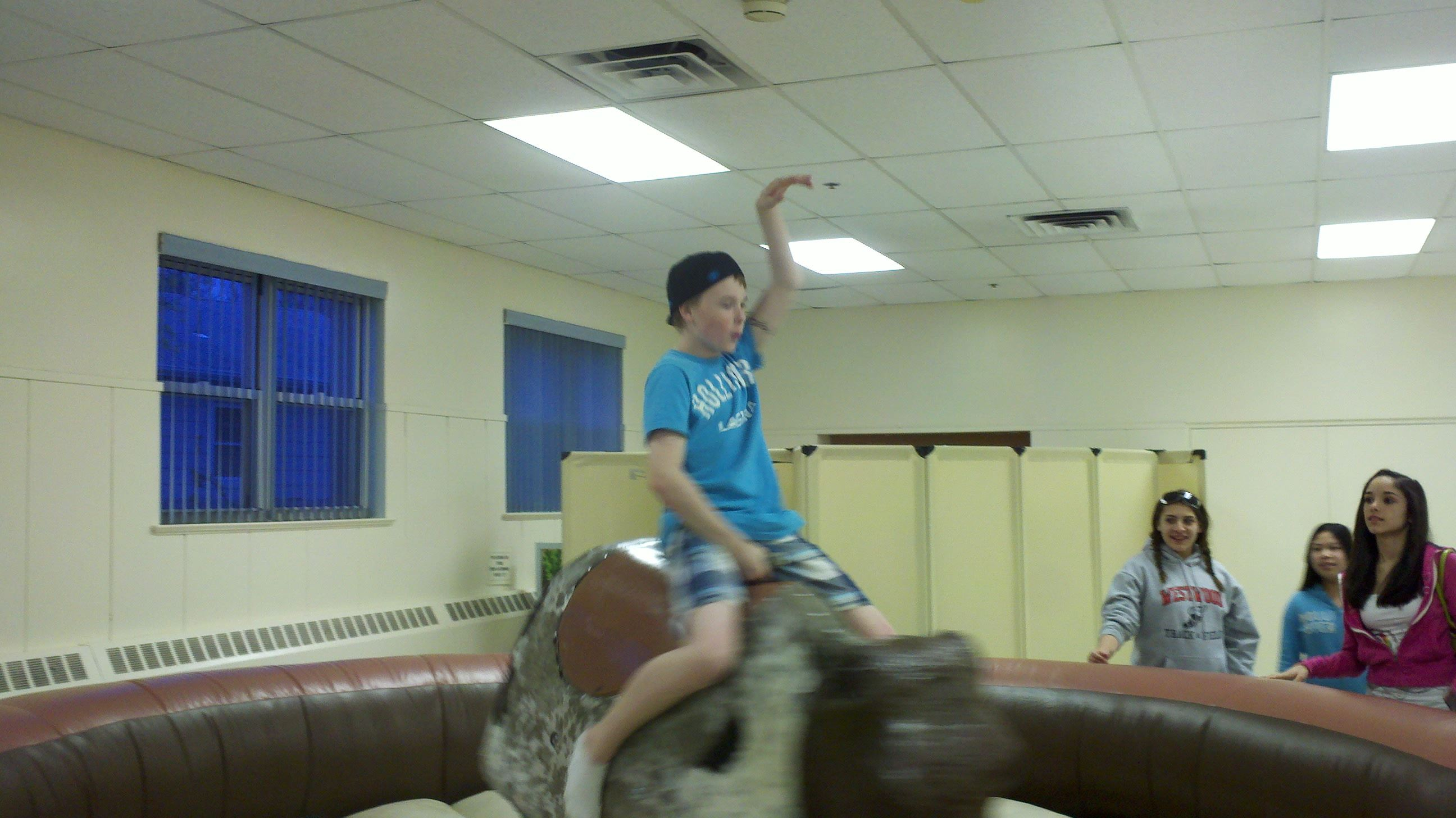 Teen Rides a Mechanical Bull
