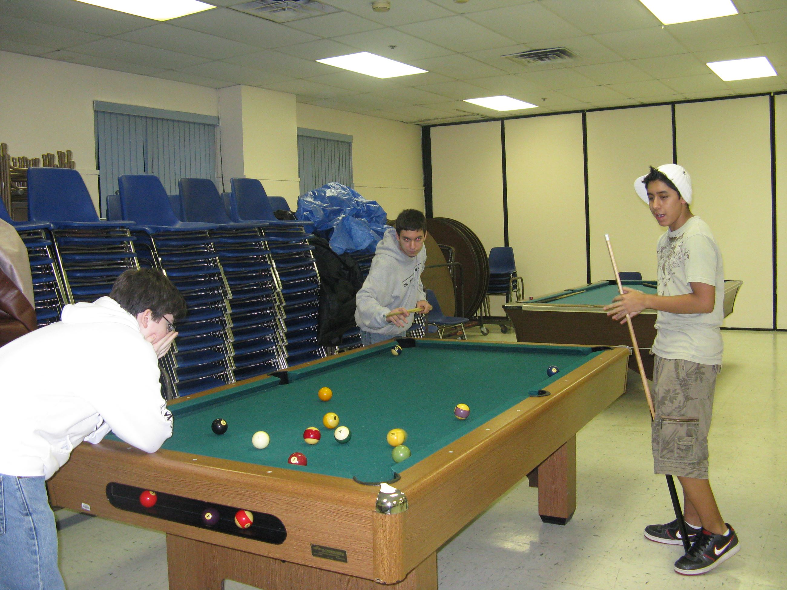 Sean Dunn, David Moreno and Brandon Conti Enjoy a Game of Pool